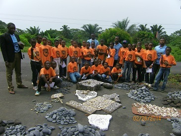 Remains of the Eruption1.Students of form one in a group picture with teachers