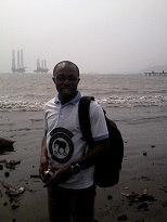 Outreach officer Mr. Innocent Yuh at the coast